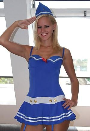Blonde teenage hottie in stockings showing her fine body