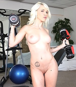 Wonderful lady is taking off her sport suit and fucking with her coach in the gym. She is taking care of this strong fellow's cock with excitement.