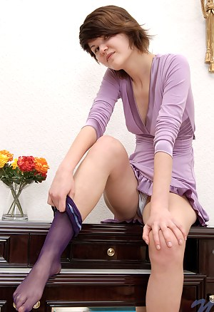 Seductive teen Sadie takes off her purple dress exposes her breast and spreads her pink pussy