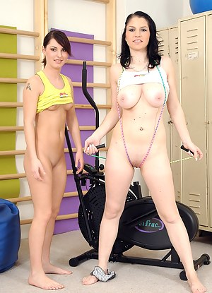 Two horny lesbian chicks working out at the gym with dildos