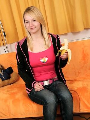 Teenage hottie loves masturbating with a huge banana toy