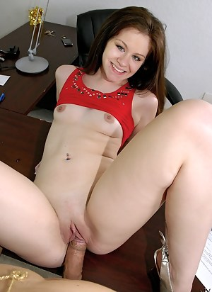 Horny brunette is enjoying passionate closeness with her client in the office. He is penetrating her mouth and pussy on the table.