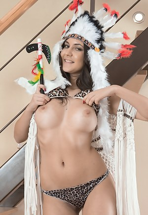 Pavla has on an Indian headdress and blue dress. She strips naked and lays on her wooden floor. She peels apart her hairy pussy lips and then climbs on the stairs to show off her body in new ways.