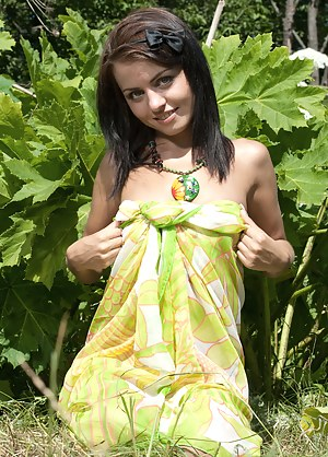 Lovely filly gracefully stripping and showing off her nice tits and ass among the greenery.