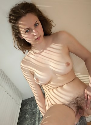 Look in the window and you might see a sexy natural beauty like Katie getting nude and naughty with her hairy pussy!