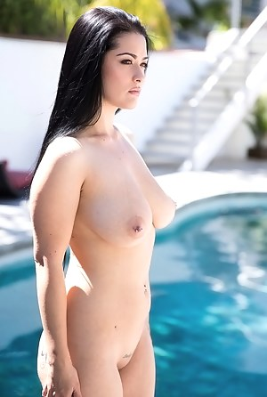 Welcome to the dirty reality of this awesome brunette woman having tattoo on her arm. She is having fun in the pool and getting wet holes penetrated.