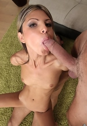 Lovely blonde is taking care of two strong dicks of her lovers when riding her big dildo. She is getting covered with loads of jizz with passion.