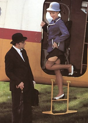 A retro flight attendant enjoys screwing a chap outdoors