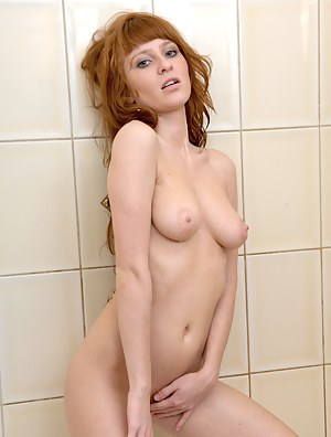 Fresh girl Polina washes off her sweet pussy in the bathtub
