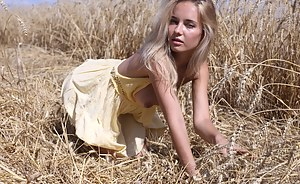 Stunning teen model gets naked in the fields where her food is grown to give some her sexiness to the country side.