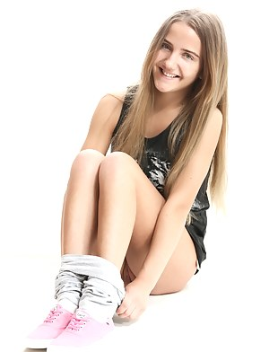 Perfect long haired teen in pink sneakers undressing and showing her naughty shaved pussy.