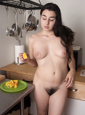 Wara quickly strips down to her sexy curvy body in the kitchen and slowly eats a slice of orange. Her supple lips drip of juices as she finishes it.