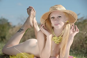 This slender teen brings her hot curves out into nature so she can let some hot sun shine on all of them.
