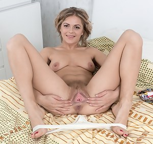 Ayda is in her bed looking sexy and stripping naked. She strips it all off and shows her hairy pussy. She stands, bends over, spreads wide, and shows her 29 year-old natural body in its bliss.