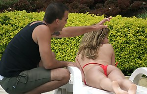 Busty chick is sunbathing next to the big pool. She is taking off her sexy red bikini and diving into the deep ocean of wild sex with the stranger.