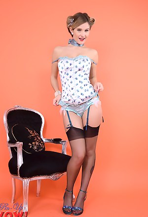 Gorgeous Elle Richie delivers a perfect striptease from sexy satin corset and black stockings.