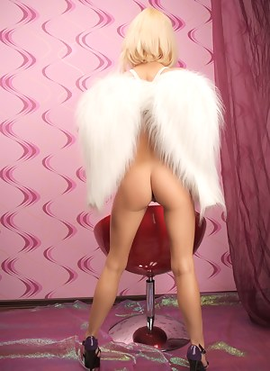 Magnificent blonde teenie strips down and poses with just angel wings on her naked body.