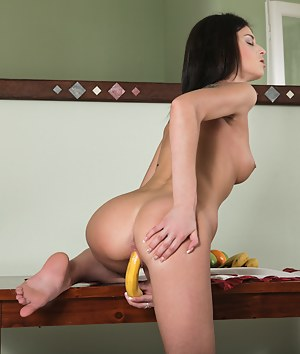 Nubiles Denisa Doll stuffs a banana into her tight pussy