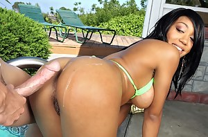 Brutal guy having extremely big penis is satisfying lovely ebony slut with passion. He is torturing her sweet holes wildly outdoor.